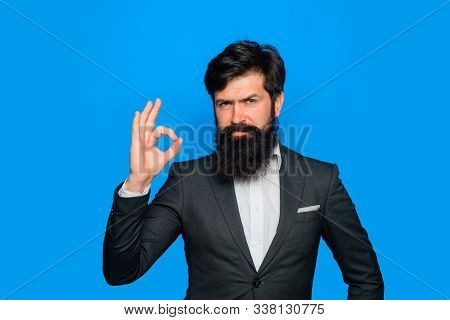 Handsome Bearded Man In Suit Shows Ok Sign. Cool Man Doing Okay Symbol. Business Success Concept. Su