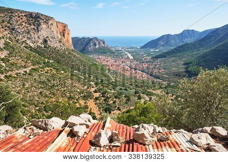 Leonidio Village And Impressive, Tall, Red Limestone Walls As Seen From Aresos Climbing Sector, A Cl