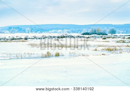 Winter Landscape Of Lake Covered With Ice