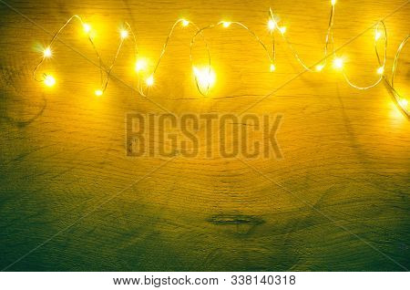 Christmas Garland Light On A Wooden Background