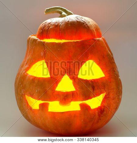 Halloween Pumpkin Head On A Gray Background
