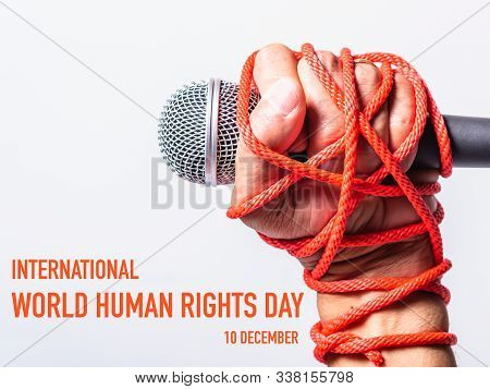 Hand Holding Microphone And Have Roped On Fist Hand With 10 December International Human Rights Day