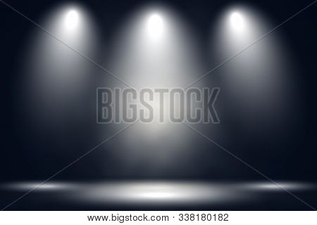 White Stage With Spot Lighting And Fog In Black Background.