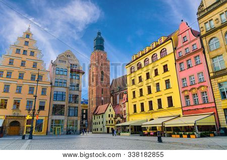 Row Of Colorful Buildings With Multicolored Facade And St. Elizabeth Minor Basilica Garrison Catholi