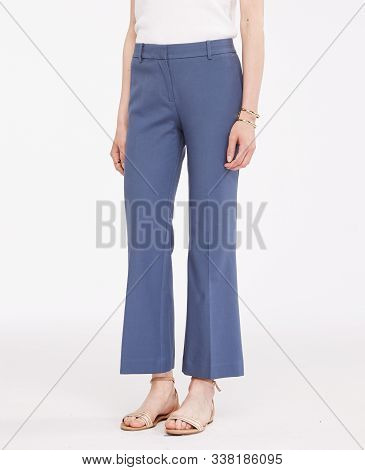 Blue Formal Pants For Women's Paired With White Full Sleeve T-shirt And Flat Footwear With White Bac
