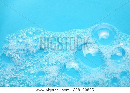 Background Soap Suds (foam) And Bubbles From Detergent. House Cleaning Concept.