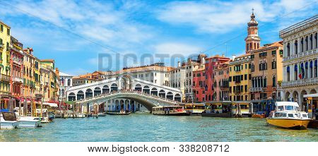 Panoramic View Of Grand Canal, Venice, Italy. Rialto Bridge In The Distance. It Is Famous Landmark O