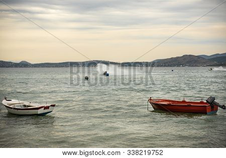 Jetski Against Traditional Wooden Fishing Boats At Sunset