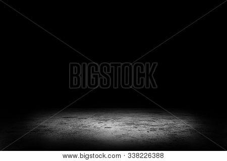 Abstract Image Of Studio Dark Room Concrete Floor Texture Background With Spotlight.