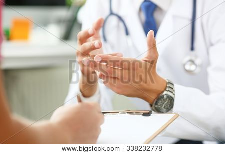 Mid Section Of Male Doctor Explaining Treatment Plan To Patient In His Office. Physical, Exam, Er, D