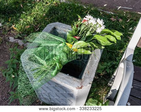 flowers in the trash, bouquet in the urn, discarded bouquet poster