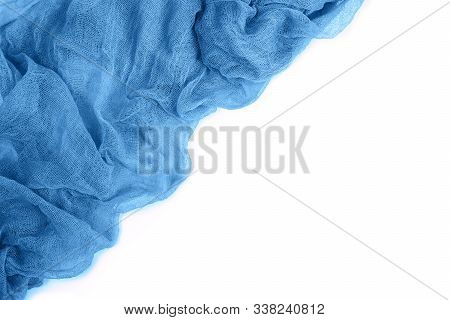 Top View Of Blue Colorful Gauze Fabric Isolated On White Background With Copy Space. Flat Lay. Trend