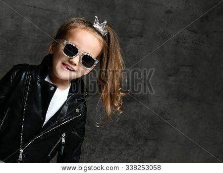 Cool Frolic Kid Girl With Silver Crown Hairpin And In Leather Jacket And Sunglasses Popped-up Smirks