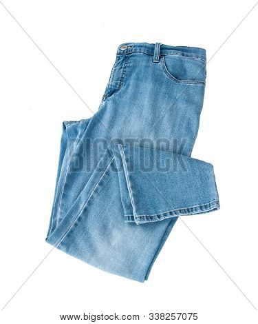 Blue Jean Pants Folded Flat Lay Isolated On A White Background.  Fashion Casual Pants Pair Of Denim
