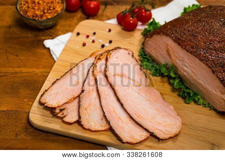Cajun Style Roasted Turkey Breast Deli Sliced Lunch Meat On Wooden Background. Selective Focus.