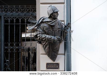 Riga / Latvia - 01 December 2019: Sculpture Of Sherlock Holmes On The Facade Of Building