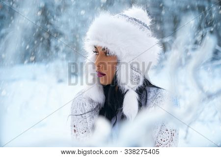 Beautiful, Conceived Model Posing In Winter Forest On Blurred Background. Attractive Girl Wearing In