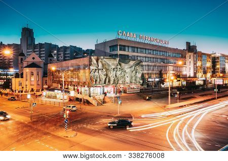 Minsk, Belarus - April 3, 2017: Evening Night Traffic Near Cathedral Of Saints Peter And Paul And Ba