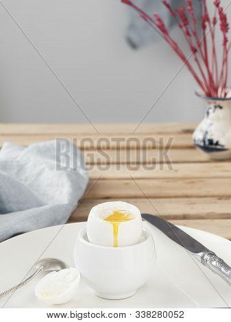Soft-boiled Egg, White Egg On A Wooden Brown Table. White Ceramic Plate With Soft-boiled Egg. Mornin