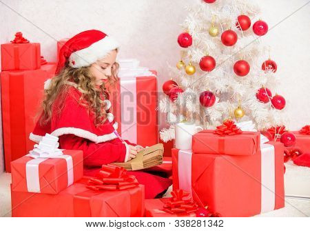 Writing Letter To Santa Claus. Winter Tradition. Kid Cute Girl Writing Email Letter On Laptop. Moder