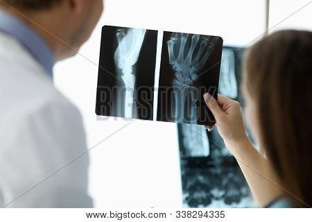 Focus On Female Hand Of Beautiful Woman Holding Snapshot Of Body Parts. Experienced Traumatologist A