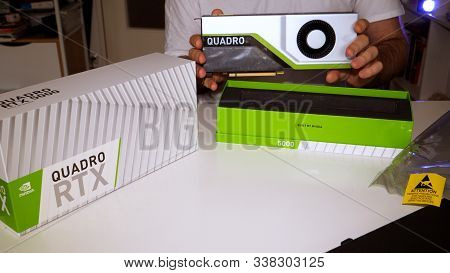 Paris, France - Mar 11, 2019: Curious Man Showing The New Nvidia Quadro Rtx 5000 For Workstations Ru