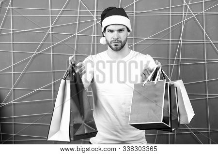 Christmas, New Year Gift, Present. Man Santa With Shopping Bags On Pink Background. Xmas Sale Concep