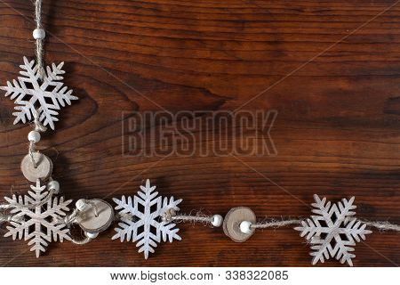 Snowflakes On Wooden Background With Copy Space. Top View And Flat Lay