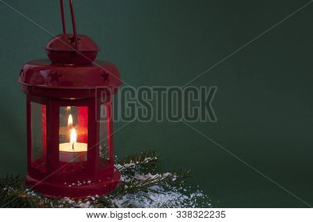 Red Christmas Lantern On Green Background With Copy Space