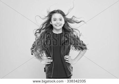 Hairdo For Her Face Shape. Happy Girl Enjoying Her New Hairdo On Yellow Background. Little Child Wit
