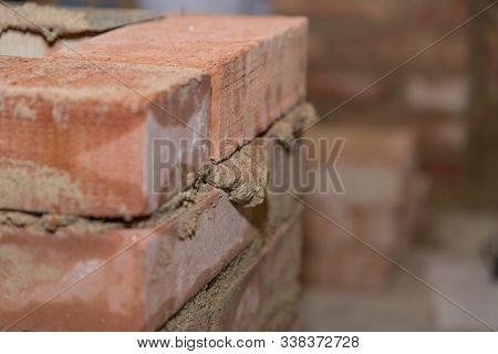 Fresh Brick Wall Made Of Small Bricks - Close-up Masonry