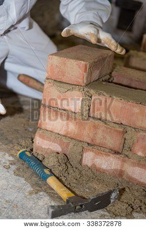 Craftsman Built With Small Bricks Wall - Closeup Mason