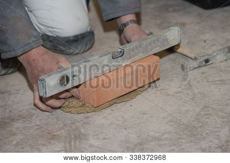 Craftsman From The Construction Walls With Brick And Mortar - Close-up