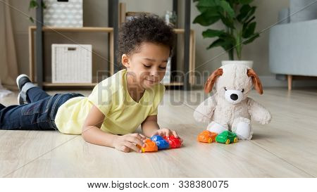 Black Little Boy Play With Toy Cars With Plush Teddy