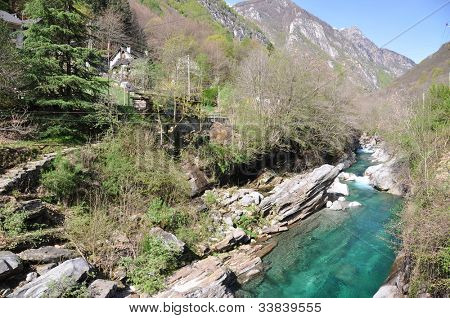 Verzasca valley. Crystal clear river and mountains in the background