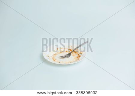 A Plate With Rests Of Tomato Sauce In It. Unwashed Dishes Illustration, Filthy Plate On Plenty Of Co