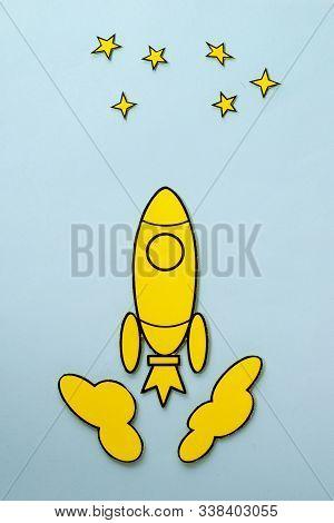 Yellow Cartoon Rocket Flying To The Stars