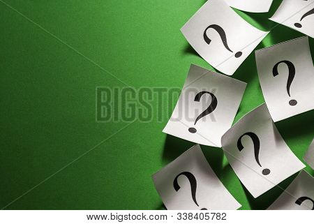 Side Border Of Scattered Question Marks On Small White Cards