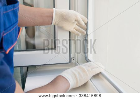 The Hands Of The Master Replace The Rubber Bands On The Plastic Window