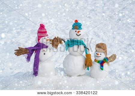 Cute Snowman In Hat And Scarf On Snowy Field. Snowman And Snow Day. Merry Christmas And Happy New Ye