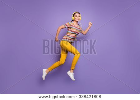 Full Body Photo Of Pretty Lady Jump High Listen Cool Earflaps Songs Run Outdoors Active Way Of Life