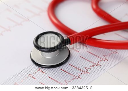 Close-up Of Healthy Results Of Electrocardiogram. Tool For Examine Respiration And Heartbeat. Red Do