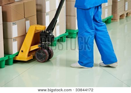 medical warehouse works by lifting stacking equipment and boxes with medcine drugs stack arrangement