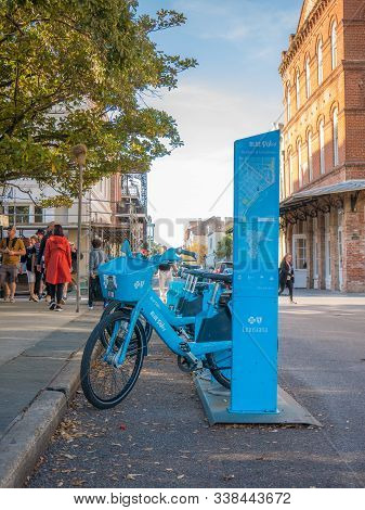 New Orleans, Usa. December 2019. Row Of Many Blue Bicycles Bikes On Rack Bike Share