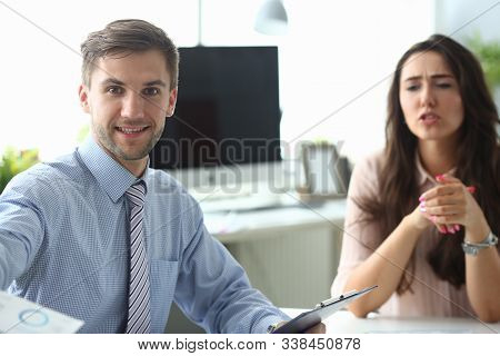 Portrait Of Smiling Young Businessman Presenting Weekly Report To Colleague. Planning Biz Conference
