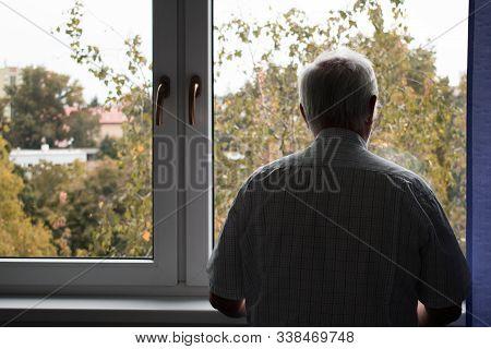 Sad Senior Man Stand Alone At Home Inside Closeup Depressed