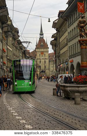 Bern, Switzerland-october 23,2019:view Of Vintage Building And Green Tram Transportation Is Old And