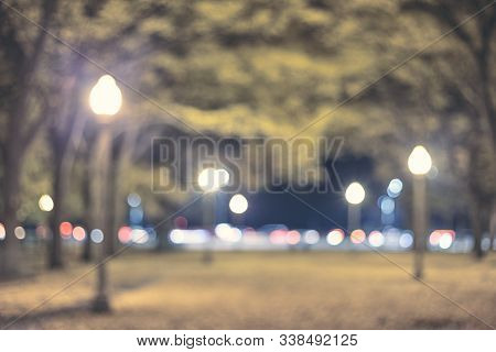 Blurred Picture Of A City Park At Night, Color Toning Applied.