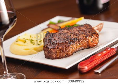 A delicious Bone In Rib-Eye Steak, narrow focus on meat