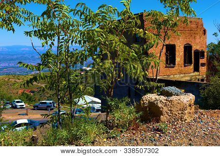 October 17, 2019 In Jerome, Az:  Abandoned Collapsing Buildings On A Mountain Plateau Overlooking Th